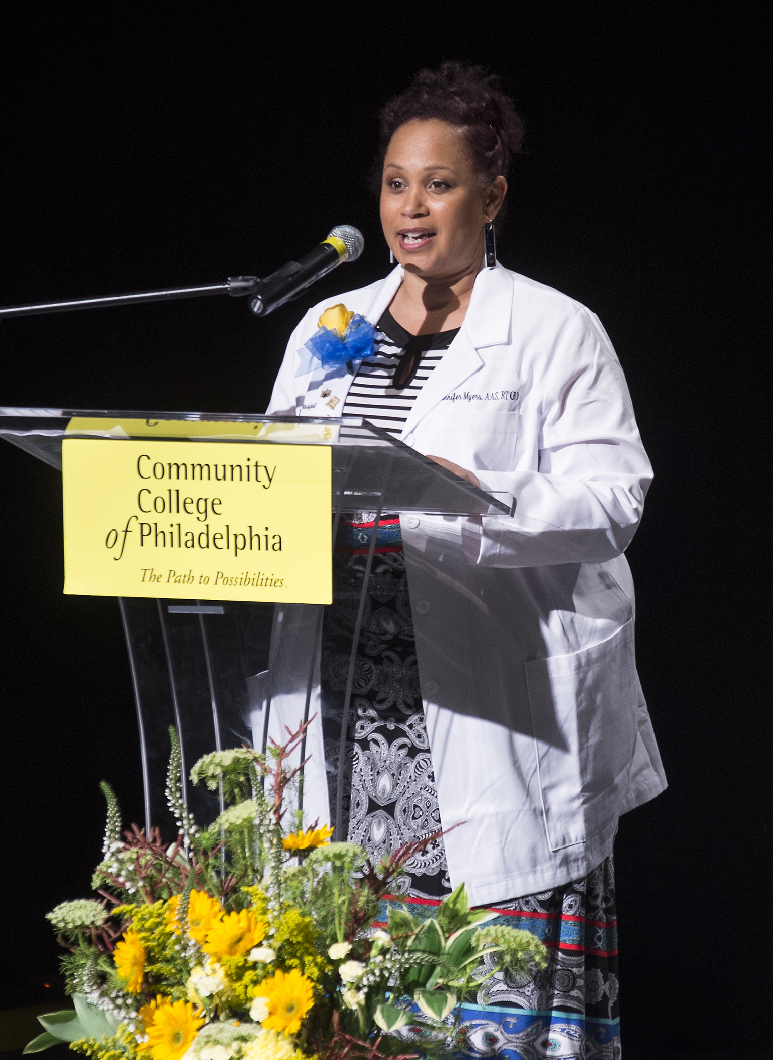 Student in the Diagnostic Medical Imaging program at a CCP podium.