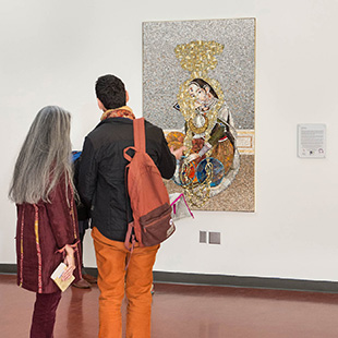 2 people looking at artwork on campus