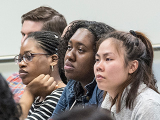 Students attending a session watching presenter who is not in frame