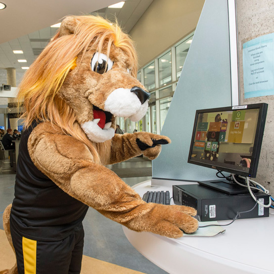 College mascot, Roary, using computer to register for classes