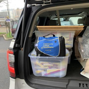 Nursing equipment in the back of a car, getting ready to be transported to healthcare professionals in need