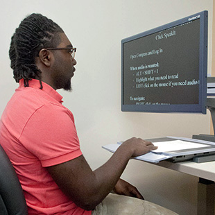 Student using large text reading machine in C.O.D.