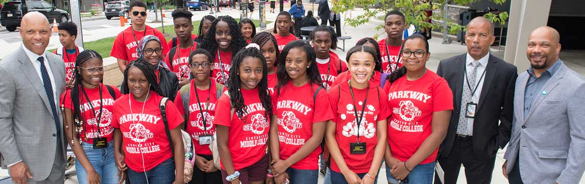 Philadelphia School Supt. Dr. William Hite (left), and Dr. Donald Guy Generals (right), pose with students from Parkway Center City Middle College High School before they set off for their first day of college-level classes.
