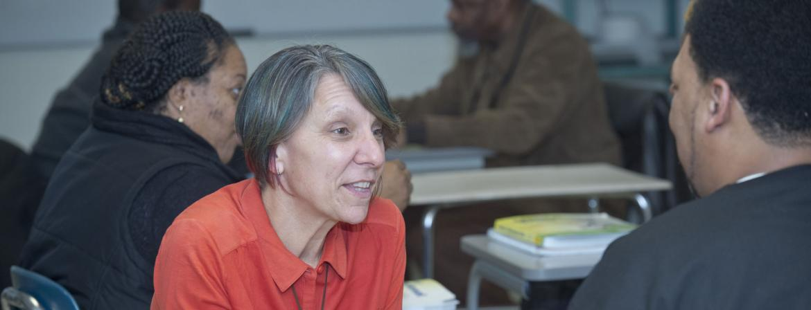 Professor interacting with students in a classroom at Community College of Philadelphia.