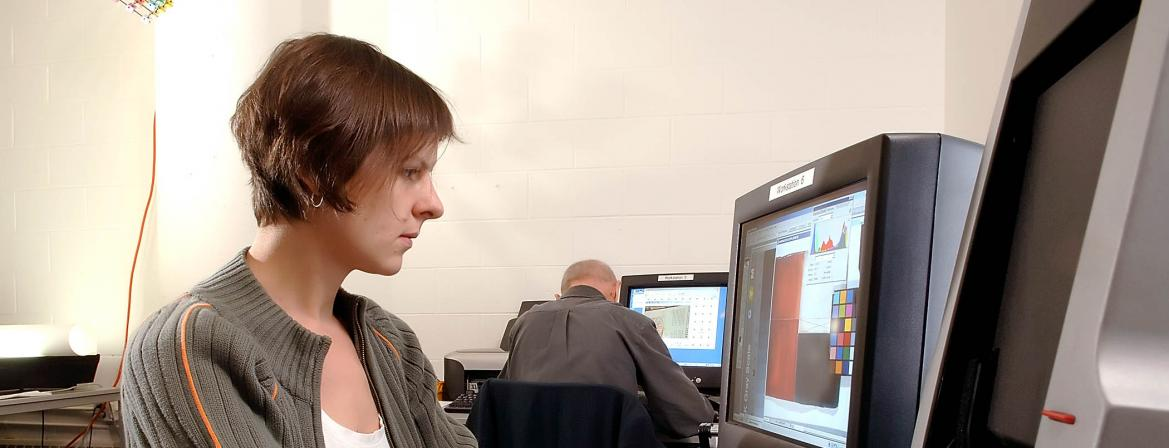 Student using graphic design software in classroom at CCP.