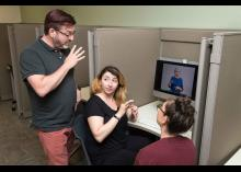Students learning about ASL in computer lab at CCP.