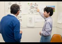 Architecture showing design work to teacher in CCP class.