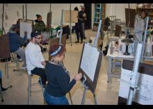 Art students painting in CCP class.
