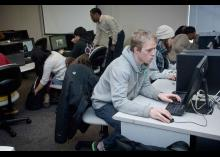 Students learning about Art and Design in computer lab at CCP.