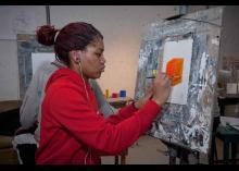 Student finishing art work in CCP class.