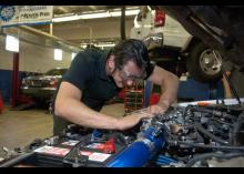 Automotive Service student working on car in CCP class.