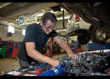 Automotive Technology student repairing car at CCP.