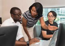 Students learning in a computers class at CCP.