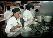 Student stirring ingredients in Culinary Arts program at CCP.