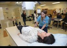 Student performing SMI practices on patient in class at CCP.
