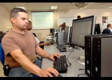 Student in Digital Forensics program working on computer at CCP.