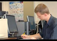 Digital Forensics student working on computer in classroom at CCP.