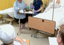 CCP nursing students learning in lab.