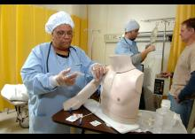 CCP student learning how to insert needle in nursing lab.