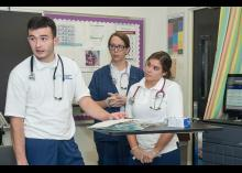 Nursing students practicing techniques in the classroom.