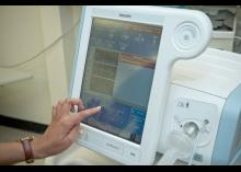 CCP student pressing on screen of equipment in Respiratory Care Technology program.