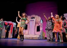 Theater students performing on stage at Community College of Philadelphia.