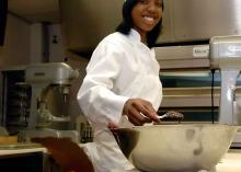 Student coking in CCP Culinary Arts program.