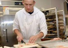 Student prepping food in Culinary Arts program at CCP.