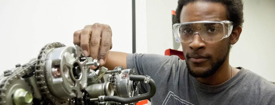Student working on a car engine at Community College of Philadelphia.