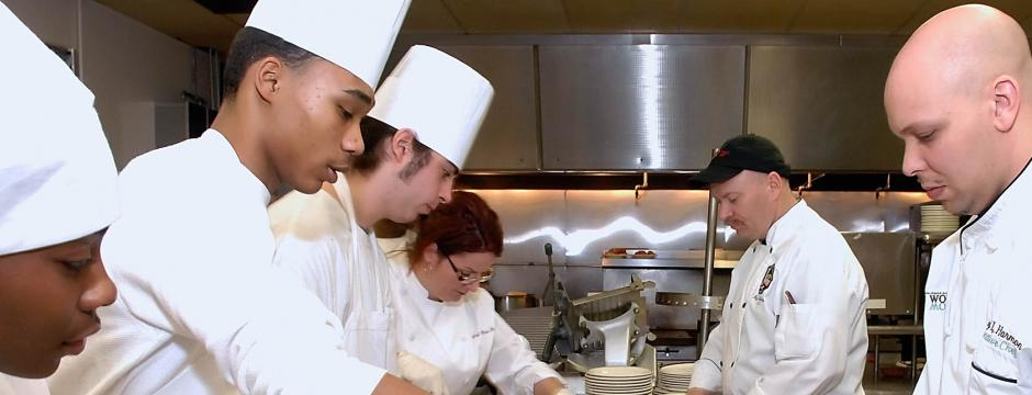 Students and faculty in production kitchen at Community College of Philadelphia.