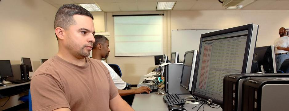 Student at computer in CCP classroom.