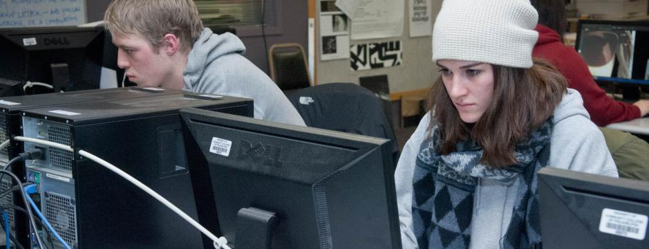 Student at computer in classroom at CCP.