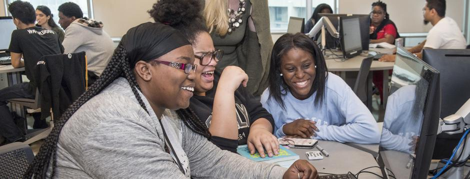 Students working together at computer at Community College of Philadelphia.
