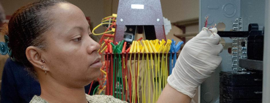 Student using testing equipment in lab at Community College of Philadelphia.
